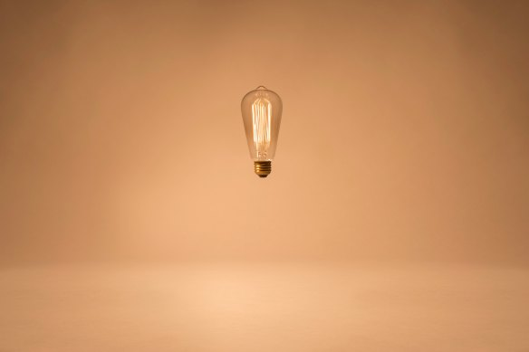 A single lit light bulb